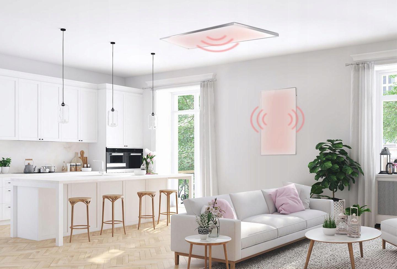 Salon z panelami grzewczymi na ścianie i suficie
