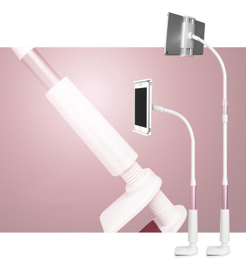 Uchwyt na telefon i tablet na różowym tle