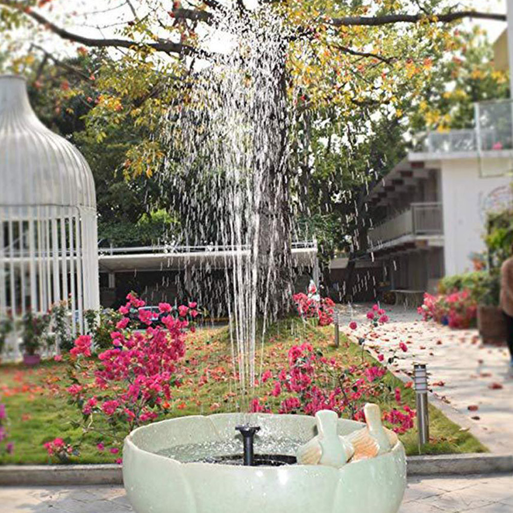 Fontanna ogrodowa zamontowana w podstawie kamiennej